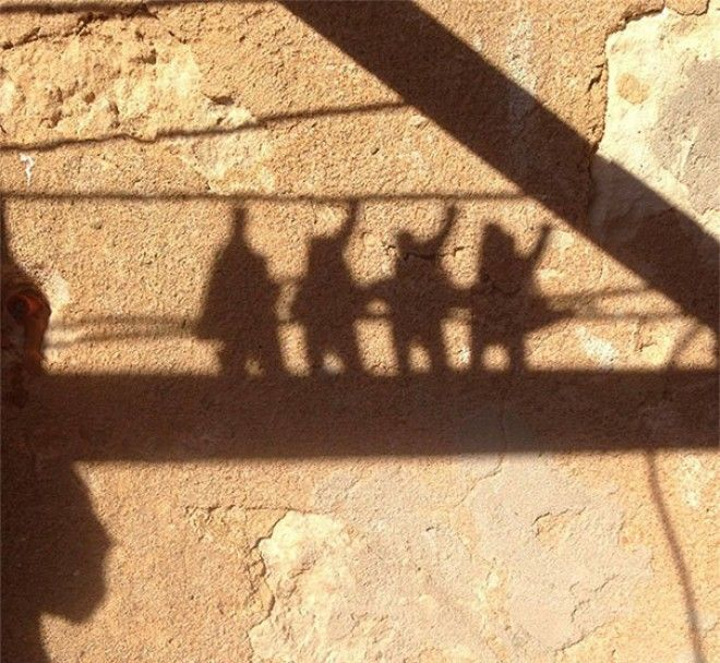 The Shadow Cast By Pegs On My Clothes Line Looks Like A Rock Band Finishing A Set