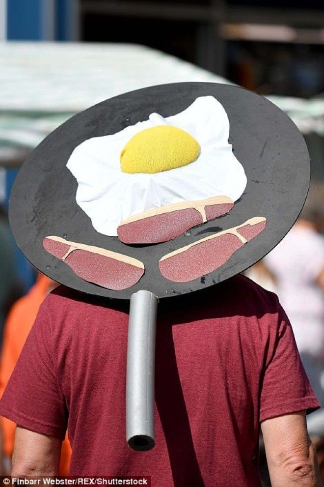 A man proudly dons a breakfast hat during the festival