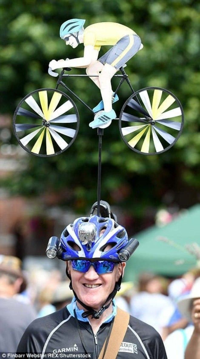 This avid cyclist (left) could not be more proud of his exquisitely-crafted headgear