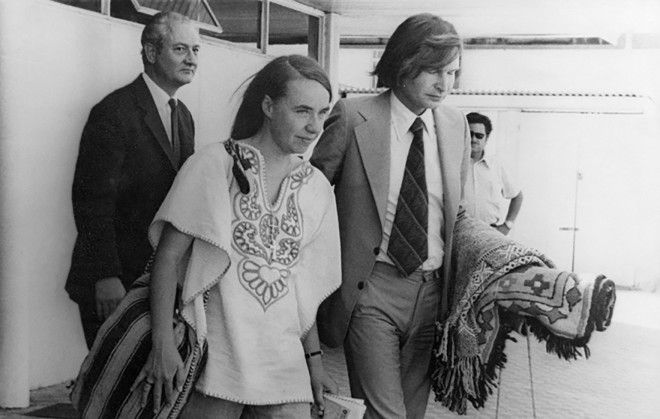 Kozak escorts British doctor Sheila Cassidy to the plane taking her out of Chile in 1975