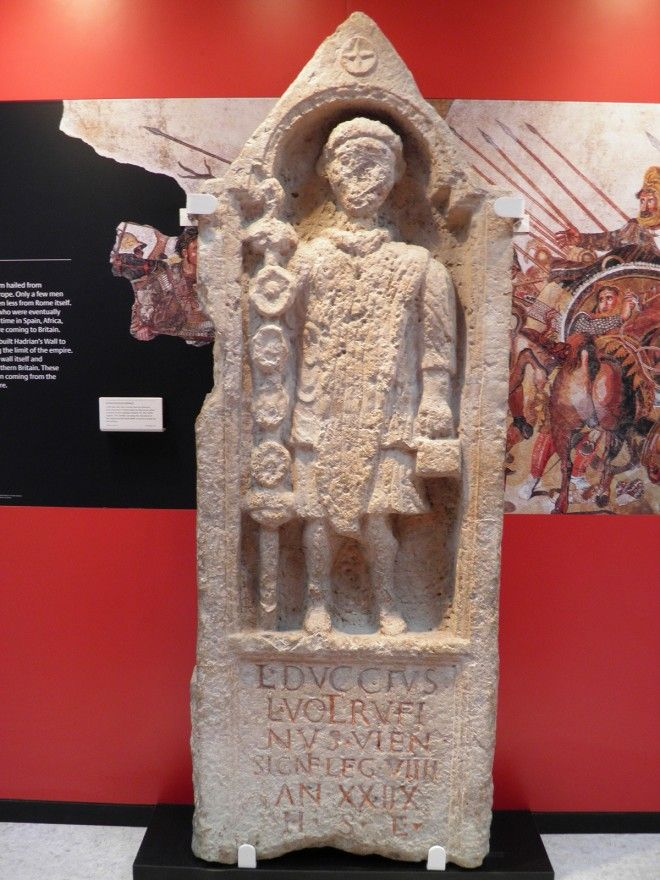 A Roman-era stone slab at the Yorkshire Museum, York, with an inscription below a carved figure of a signifer or standard bearer in the 9th Hispanic Legion