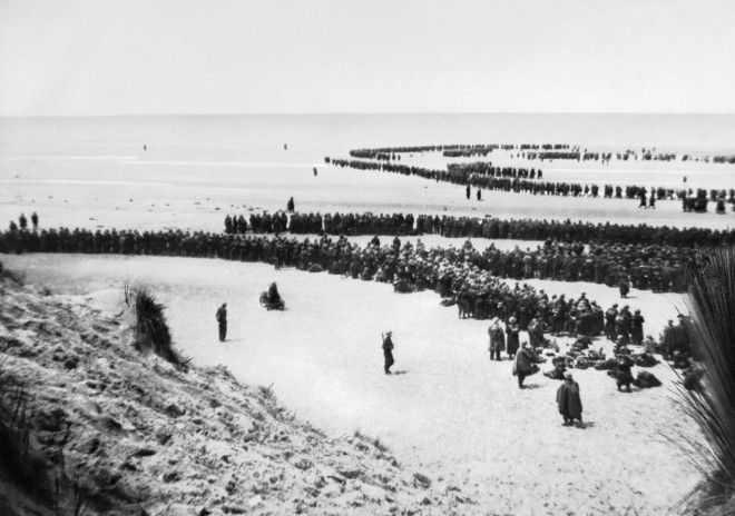 British troops line up on the beach at Dunkirk to await evacuation